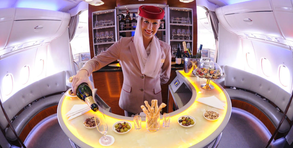 Emirates-A380-Cabin-Crew-serving-champagne-in-Onboard-Lounge-990x500