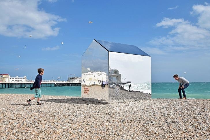 Mirror beach hut installed on beach, Worthing, Britain - Jul 2015