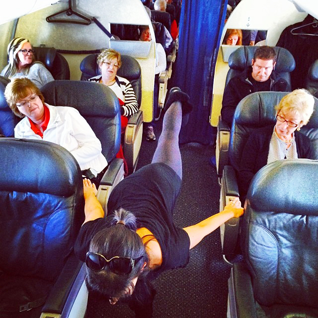 """Instagram image posted by Hilaria Baldwin showing her yoga pose of the day on 1/27 """"I'm sorry. You've never seen airplane pose at 35,000 feet? #yogapostureoftheday #hilariaypd thank you to all my fellow passenger yoga buddies!"""""""